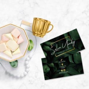 wizytówki dla stylistki paznokci z monsterami i złotym logotypem